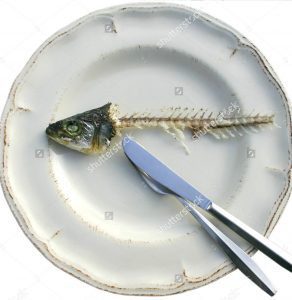 stock-photo-eaten-fish-on-clean-plate-with-intact-head-46887052